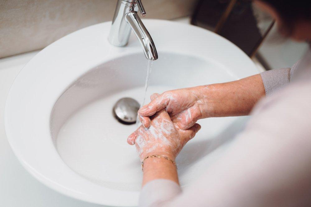 elderly washing hands